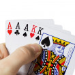 Man holding cards in hand, playing poker — Stock Photo