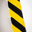Grunge background, yellow and black stripes on the wall — Stock Photo #41938381