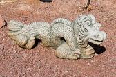 Ornamental Dragon in a Stone Garden — Stock Photo