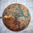 Worldwide globe over a map — Stok fotoğraf