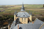 Detail fortification of Alcazar of Segovia with green country, C — Stock Photo