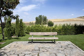 Bench in a green park — Stock Photo