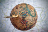 Worldwide globe over a map — Stock Photo