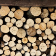 Foto Stock: Wood stacked in pile