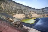 El Golfo in Lanzarote, the green lagoon - lago verde- with green — Stock Photo