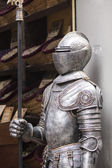 Detail of a medieval knight armor with sword — Stock Photo