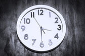A modern clock on a grungy concrete wall  — Stock Photo