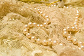 Pearls and lace — Stock Photo