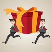Cartoon businessman carrying big gift box — Stock Vector