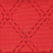 Largest stitches on red cloth — Stock Photo