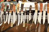 Different types of knives are sold in a small market  Kabardino-Balkaria. — Stock Photo
