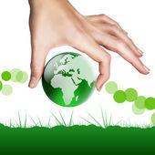 Fingers holding globe — Stock Photo