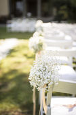 May-lily on wedding chair — Stock Photo