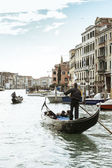 Gondoliers with tourists — Stock Photo