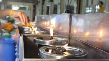 Buddhist fill some oil into oil lamps — Stock Video