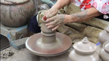 Close up of hands making earthen jar on a wheel in traditional Thailand style — Stock Video