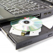 Stock Photo: CLoseup CDROM Tray and diskette on Laptop
