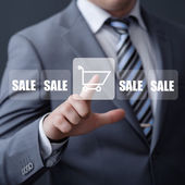 Businessman pressing promotion and shipping type of modern buttons — Stock Photo