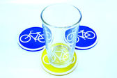 Glass on Coaster bicycle symbol — Stock Photo