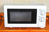 Microwave oven on the table — Stock Photo