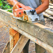 Hand carpenter using wood planer — Stock Photo