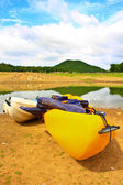 Kayaks, canoe on the edge of the water in Lake — Stock Photo