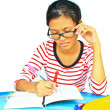 Young girl  homework on the table — Stock Photo
