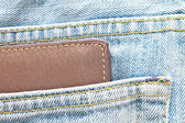 Cartera marrón en pantalones vaqueros pantalones bolsillo trasero — Foto de Stock