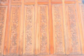 Art of carving on wooden wall — Stock Photo