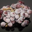 Frozen grapes or Grapes in ice Isolation on the black background — Stock Photo