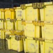 Yellow packing boxes are prepared for wholesale fish market. — Stock Photo