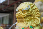 The head of chinese lion statue — Stock Photo
