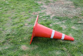 Traffic cone on the garden ground — Стоковое фото