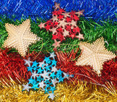 Christmas decorations and ornaments on colorful background — Stockfoto