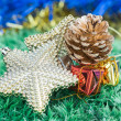 Christmas decorations and ornaments on green grass background — Stock Photo #37280471