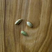 Three grains of cardamom  — Stock Photo