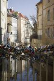 Many love locks on the bridge in Prague  — Stock Photo