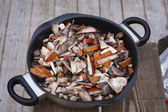 Sliced orange cap boletus in a skillet — Photo