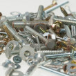 Screws, nuts, and bolts on isolated white background — Stock Photo