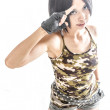Asian female in military camouflage saluting — Stock Photo