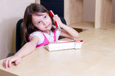 Child on telephone in office — ストック写真