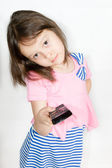 Child with a remote control — Stock Photo