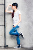 Asian girl on a ladder — Stock Photo