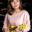Stock Photo: Pretty Asiwomwith ukelele