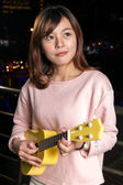 Pretty Asian woman with ukelele — Stock Photo