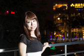 Attractive Asian Woman in front of Mall with bright LIghts — Stock Photo