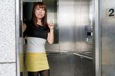 Beautiful Asian Woman Standing by Elevator — Stock Photo