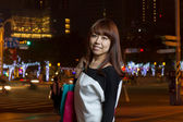 Attractive Asian woman shopping in City — Stock Photo