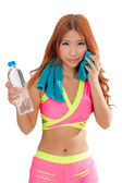 Attractive Asian woman with water bottle and towel after exercis — Zdjęcie stockowe
