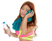 Attractive Asian woman with water bottle and towel after exercis — Stock Photo